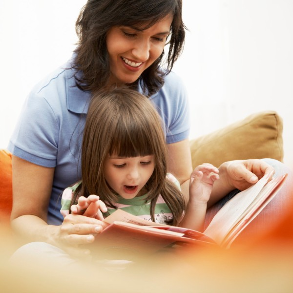 Mother and Daughter Reading Together --- Image by © Royalty-Free/Corbis